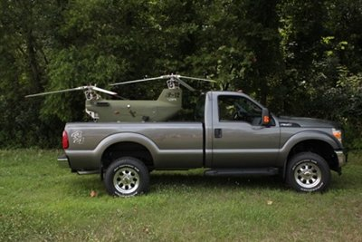 The DP-12 is designed to fit in and land/launch from standard vehicles, such as the bed of a pickup truck or humvee, or small utility trailer.  The rotor blades can be removed and/or installed in about 5 minutes for transport.